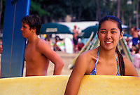 Teen surfers on waikiki beach with boards
