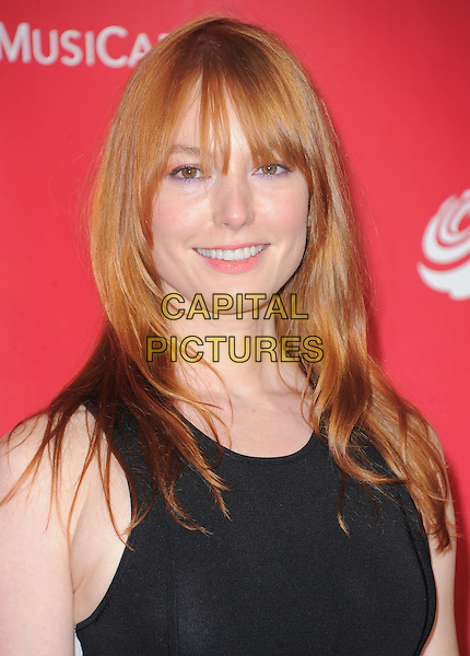 Alicia Witt.The MusiCares 2013 Person Of The Year Tribute held at The Los Angeles Convention Center, West Hall in Los Angeles, California, USA..February 8th, 2013.headshot portrait black .CAP/RKE/DVS.©DVS/RockinExposures/Capital Pictures.