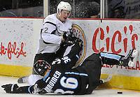 San Antonio Rampage right wing Logan Shaw takes down Milwaukee Admirals defenseman Joonas Jarvinen during the second period of an AHL hockey game, Thursday, Jan. 16, 2014, in San Antonio. (Darren Abate/AHL)