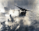 "March 3, 1943 : Bismarck Sea, Papua New Guinea - The Battle of the Bismarck Sea was a battle in the South West Pacific Area during World War II, in which planes of the United States Fifth Air Force and the Royal Australian Air Force attacked a Japanese convoy carrying troops to Lae, New Guinea (now Papua New Guinea). Most of the task force was destroyed, and Japanese troop losses were extremely high. United States Air Force were developing a new technique called ""skip bombing"": flying only a few dozen feet above the sea towards their targets, they would release their bombs, which would then, ideally, ricochet across the surface of the water and explode at the side of the target ship, under it, or just over it. (Photo by Kingendai Photo Library/AFLO)"