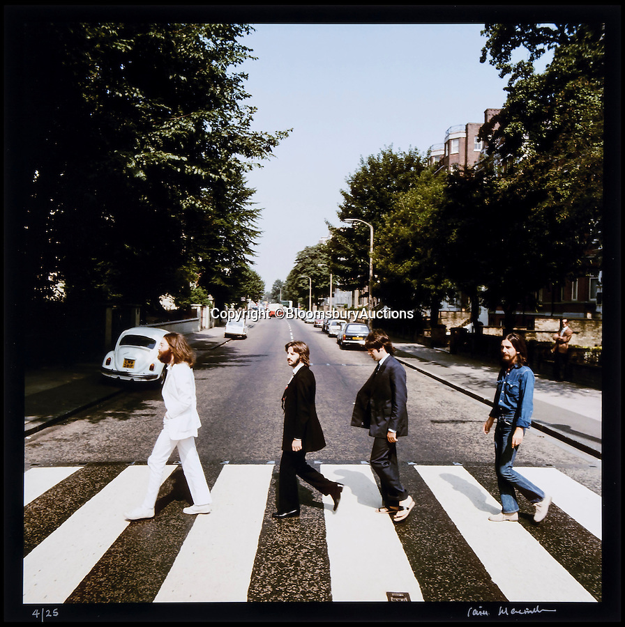 BNPS.co.uk (01202 558833)<br /> Pic: BloomsburyAuctions/BNPS<br /> <br /> ***Please Use Full Byline***<br /> <br /> An out take from the famous Abbey Road photo shoot with The Beatles. <br /> <br /> Rare photographs of the Beatles crossing Abbey Road shot for the cover of the last album they recorded together have emerged for sale for £70,000.<br /> <br /> The six snaps were rejected as possible covers of the Beatles' famed Abbey Road album released in September 1969, just months before they split up.<br /> <br /> They were taken by Scots photographer Iain Macmillan, a close friend of John Lennon, who balanced precariously on a ladder in the middle of the road in north London for the shoot.<br /> <br /> He had just 10 minutes to get his shot so he got the Fab Four to walk back and forth continuously over the now famous zebra crossing.<br /> <br /> Also for sale is the photo that became the back cover of the album - a road sign with a blurred person in the foreground.<br /> <br /> Experts say the photos could make £70,000 when they go under the hammer at Bloomsbury Auctions.