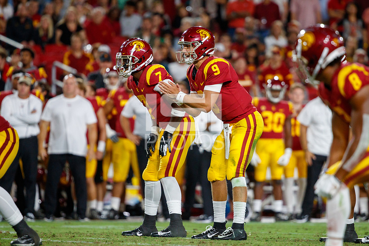 LOS ANGELES, CA - SEPTEMBER 8: USC Trojans quarterback Kedon Slovis #9 prepares for a ball snap during a game between USC and Stanford Football at Los Angeles Memorial Coliseum on September 7, 2019 in Los Angeles, California.