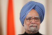 Washington, DC - November 24, 2009 -- Manmohan Singh, India's prime minister, listens to United States President Barack during a news conference Obama in the East Room of the White House in Washington, D.C., U.S., on Tuesday, November 24, 2009. Singh was welcomed to the White House this morning by Obama for a state visit where the two leaders will have discussions on curbing nuclear weapons, climate change and trade. .Credit: Andrew Harrer - Pool via CNP