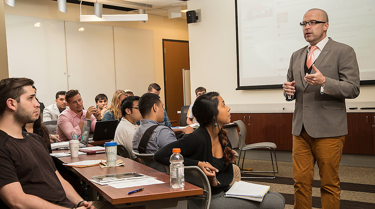Professor Patrick J. Murphy teaches undergraduate students in the Coleman Entrepreneurship Center's new home in DePaul University's Driehaus College of Business on September 21, 2016. For the first time, DePaul has a dedicated suite for entrepreneurship, located at DePaul Center  Room 7900. Students are encouraged to come by for help with their entrepreneurial ideas, business plans, and business development at all stages. The suite will provide space for students to work on their businesses, meet with clients, and attend workshops and events. The center will also host one showcase class per quarter. (DePaul University/Maria Toscano)