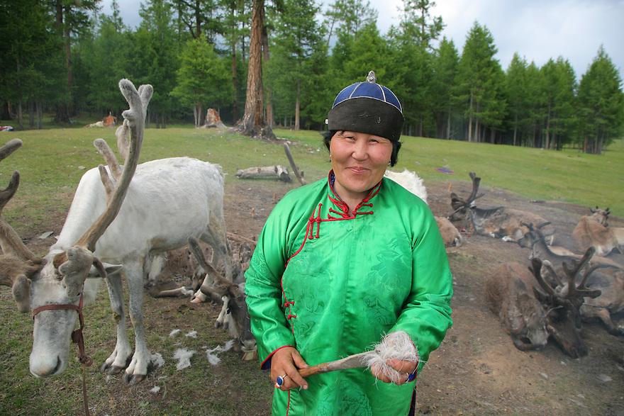 A Tsaatan woman with reindeers Khovsgol Nuur Mongolia