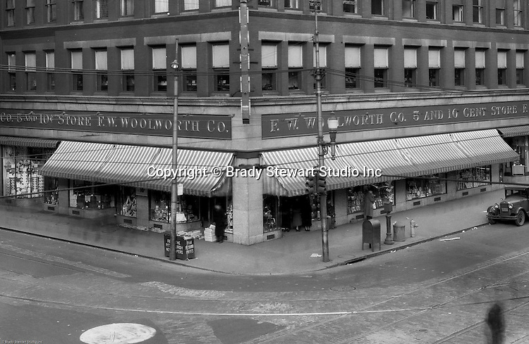 Pittsburgh PA:  View of the FW Woolworth Building at the corner of Liberty Avenue and Sixth Street - 1935.