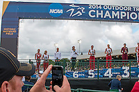 Missouri Coach Dan Lefever takes a panoramic set of photos of junior Katrine Haarklau on the awards podium after her sixth place finish in the women's pole vault at the 2014 NCAA Division I Outdoor Track and Field Championships at Hayward Field, in Eugene, Or. Friday, June 13.