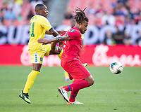 CLEVELAND, OH - JUNE 22: Roman Torres #5 and Callum Harriott #11 vie for the ball during a game between Panama and Guyana at FirstEnergy Stadium on June 22, 2019 in Cleveland, Ohio.