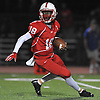 Freeport quarterback No. 18 Rashad Tucker scrambles for yards during a Nassau County Conference I varsity football game against Massapequa at Freeport High School on Friday, September 25, 2015<br /> <br /> James Escher