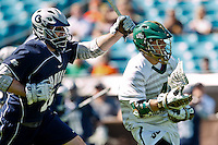 February 20, 2011:   Jacksonville Dolphins midfielder Cameron Mann (4) escapes Georgetown Hoyas midfielder Max Seligmann (10) during Lacrosse action between the Georgetown Hoyas and Jacksonville Dolphins during the Moe's Southwest SunShine Classic played at EverBank Field in Jacksonville, Florida.  Georgetown defeated Jacksonville 14-11.