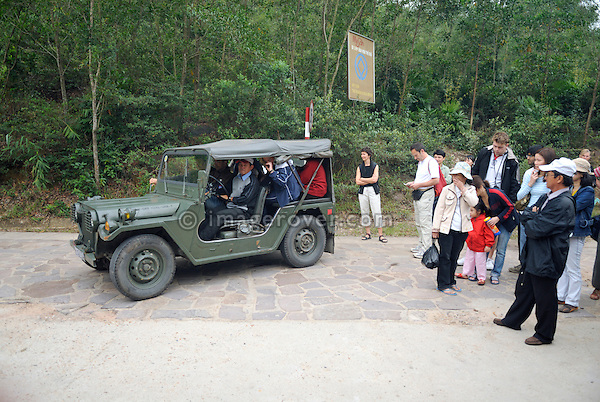 Asia, Vietnam, My Son near Hoi An. Using ex-army Ford MUTT M151 4x4 tourists are driven from the gate to My Son's main site. Designated a Unesco World Heritage Site, the temple complex of My Son is located in a dense, vegetaded valley beneath Hon Quap or Cat's Tooth Mountain. Having been a religious center from the 4th to the 13th century, today traces of ca. 70 temples may be found, though only about 20 are in good condition. The monuments are divided into 10 groups.