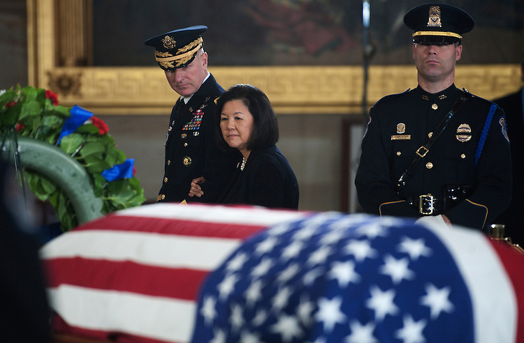 UNITED STATES - Dec 20 : Senator Daniel Inouye's wife Irene Hirano passes by the flag is draped casket of U.S. Senator Daniel Inouye (D-HI) in the Rotunda of the U.S. Capitol where he will lie in state December 20, 2012 on Capitol Hill in Washington, DC. The late Senator had died at the age of 88 on Monday at the Walter Reed National Military Medical Center in Bethesda, Maryland where he had been hospitalized since early December. A public funeral service will be held at the Washington National Cathedral on Friday for Senator Inouye, a World War II veteran and the second-longest serving senator in history. His remains will be returned and laid to rest in his home state.  (Photo By Douglas Graham/CQ Roll Call)