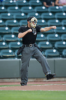 Home plate umpire Tyler Olson calls a batter out on strikes during the Carolina League game between the Frederick Keys and the Winston-Salem Dash at BB&T Ballpark on May 24, 2016 in Winston-Salem, North Carolina.  The Keys defeated the Dash 7-1.  (Brian Westerholt/Four Seam Images)