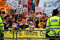 Pro-Tibet protesters opposite the entrance to Downing Street (the office and residence of the Prime Minister) in Whitehall on the day when the Olympic torch was paraded through the streets of London.