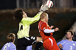 11 November 2005: North Carolina goalkeeper Justin Hughes (left) stretches to keep the ball off the head of Clemson's Mark Buchholz (right). The University of North Carolina defeated Clemson University 2-0 at SAS Stadium in Cary, North Carolina in a semifinal of the 2005 ACC Men's Soccer Championship.