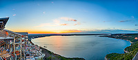 This is the another great sunset on Lake Travis at the Oasis with the full lake in view in this panorama.  We have been a drought for years and finally the lake is almost full it so nice to see this again.  The Oasis is always a good place to watch a sunset or bring friends and family to enjoy the spectacular show that only nature can perform.   As usual it did not disappoint this evening.  Tourist come from all around to check out the view from this place.  We are always looking for that perfect sunset so we will be back for another round again I am sure.  Till then we thought this was a spectacular show.