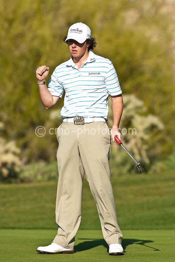 Feb 26, 2009; Marana, AZ, USA; Rory McIlroy (XNI) reacts to making a putt on the 18th hole to defeat Hunter Mahan (USA) 1 up in the second round of the World Golf Championships-Accenture Match Play Championship at the Ritz-Carlton Golf Club, Dove Mountain.