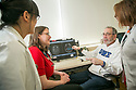 Henry Friedman, MD, talks with colleagues about a brain tumor patient's case at the Duke Cancer Center.