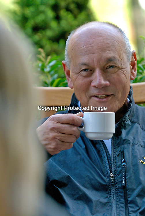 Mature man with coffee cup, smiling