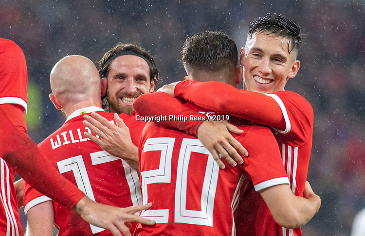 Cardiff - UK - 9th September :<br />Wales v Belarus Friendly match at Cardiff City Stadium.<br /> Daniel James of Wales is congratulated on his first half goal by Harry Wilson (right) and Captain Joe Allen (left).<br />Editorial use only