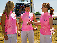 Rosie Napravnik talks with Greta Kunzweiler (center) and Rosemary Homeister a hug before introductions for the Female Jockey Challenge on Black-Eyed Susan Day at Pimlico Race Course in Baltimore, Maryland on May 18, 2012.