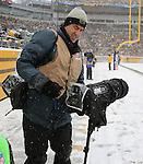 Gregory Shamus using the Think Tank Photo Hydrophobia as the Pittsburgh Steelers host the Miami Dolphins at Heinz Field on Sunday, December 8, 2013.