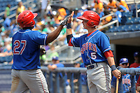 Auburn Doubledays infielder Tony Renda (5) greets Estarlin Martinez (27) during game against the Staten Island Yankees at Richmond County Bank Ballpark at St.George on August 2, 2012 in Staten Island, NY.  Auburn defeated Staten Island 11-3.  Tomasso DeRosa/Four Seam Images