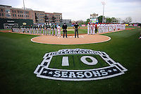 Members of the Greenville Drive and the Augusta GreenJackets line up on the field for the National Anthem on Opening Day, Thursday, April 9, 2015, at Fluor Field at the West End in Greenville, South Carolina. The Drive are celebrating the team's 10th year in Greenville. (Tom Priddy/Four Seam Images)