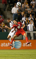 CARSON, CA – June 3, 2011: LA Galaxy defender Sean Franklin (5) and DC United forward Josh Wolff (16) go high to head the ball during the match between LA Galaxy and DC United at the Home Depot Center in Carson, California. Final score LA Galaxy 0, DC United 0.