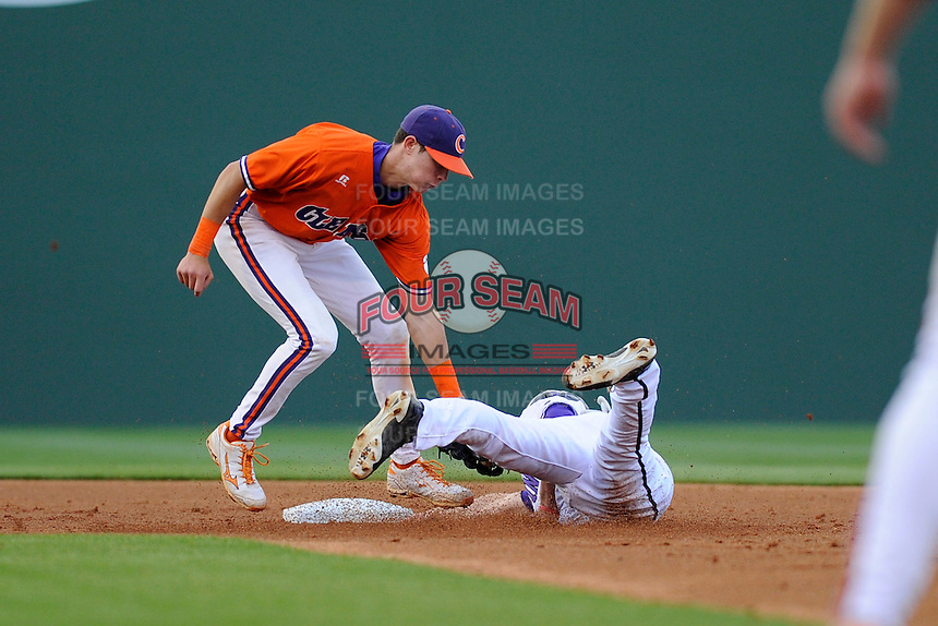 Infielder Tyler Krieger (3) of the Clemson Tigers tags out Greg Harrison (22) of the Furman Paladins attempting to steal second in a game on Wednesday, May 8, 2013, at Fluor Field at the West End in Greenville, South Carolina. (Tom Priddy/Four Seam Images)