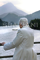 Pope Benedict XVI walk on the banks of a river of mountain while, of private vacations in the Dolomite. Pope Benedict XVI looks at the' centre Cadore' lake in Domegge, Lorenzago di Cadore, in the Italian Alps, northern Italy, Monday, July 23.2007.