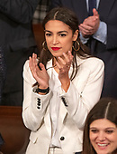 United States Representative Alexandria Ocasio-Cortez (Democrat of New York) applauds the remarks of Speaker of the US House of Representatives Nancy Pelosi (Democrat of California) as the 116th Congress convenes for its opening session in the US House Chamber of the US Capitol in Washington, DC on Thursday, January 3, 2019.<br /> Credit: Ron Sachs / CNP<br /> (RESTRICTION: NO New York or New Jersey Newspapers or newspapers within a 75 mile radius of New York City)