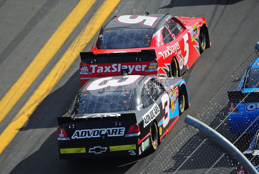 Feb. 25, 2012; Daytona Beach, FL, USA; NASCAR Nationwide Series driver Dale Earnhardt Jr (5) is bump drafted by Austin Dillon (3) during the DRIVE4COPD 300 at Daytona International Speedway. Mandatory Credit: Mark J. Rebilas-