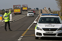 Pictured: Officers from Dyfed Powys Police, perform spot checks on drivers using Cleddau Bridge in Pemrokeshire, Wales, UK.<br /> Re: Covid-19 Coronavirus pandemic, UK.