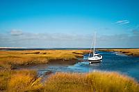 Sailboat anchored in salt marsh, Wharf Lane, Yarmouthport, Cape Cod, MA, Massachusetts