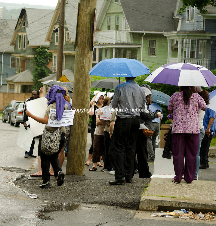 WATERBURY, CT- 18 June 2013 061813AP07- Members of  New England Health Care Employees Union, District 1199, SEIU, protest outside of Waterbury Hospital Heath Center in the rain.  Alexandra Pape Republican-American