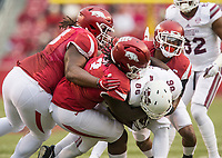 Hawgs Illustrated/BEN GOFF <br /> Bijhon Jackson (from left), McTelvin Agim, and Kevin Richardson of Arkansas tackle Jesse Jackson (28), Mississippi State wide receiver, in the first quarter State Saturday, Nov. 18, 2017, at Reynolds Razorback Stadium in Fayetteville.