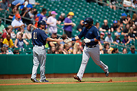 Mobile BayBears manager David Newhan (11) congratulates Julian Leon (20) as he rounds the bases after hitting a home run during a Southern League game against the Montgomery Biscuits on May 2, 2019 at Riverwalk Stadium in Montgomery, Alabama.  Mobile defeated Montgomery 3-1.  (Mike Janes/Four Seam Images)