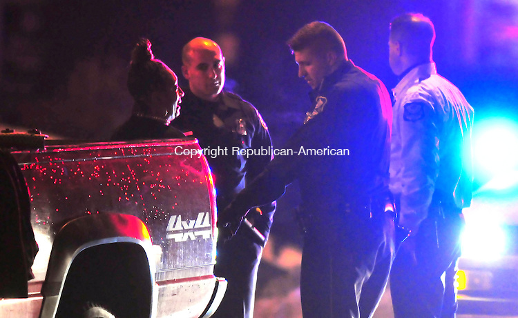 WATERBURY, CT- 27 DECEMBER 2008 --122708JS12-Waterbury police question a person who was in a truck that was involved in a hit and run accident in Waterbury on Saturday night. <br /> Jim Shannon / Republican-American