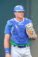 Catcher Chad Johnson (7) of the Lexington Legends warms up before a game against the Greenville Drive on Friday, August 29, 2014, at Fluor Field at the West End in Greenville, South Carolina. Greenville won, 6-1. (Tom Priddy/Four Seam Images)