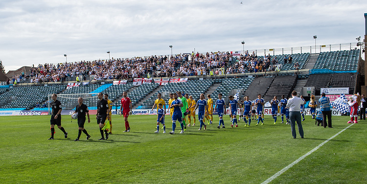 Match officials lead the player onto the pitch<br /> <br /> Photographer David Horton/CameraSport<br /> <br /> The EFL Sky Bet League One - Gillingham v Bolton Wanderers - Saturday 31st August 2019 - Priestfield Stadium - Gillingham<br /> <br /> World Copyright © 2019 CameraSport. All rights reserved. 43 Linden Ave. Countesthorpe. Leicester. England. LE8 5PG - Tel: +44 (0) 116 277 4147 - admin@camerasport.com - www.camerasport.com