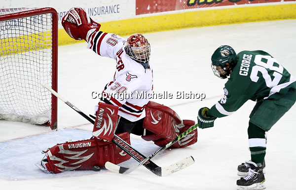 Nebraska-Omaha goalie John Faulkner stops Bemidji State's Jordan George during a breakaway in the second period. Bemidji State beat UNO 3-2 Saturday night at Qwest Center Omaha to win the best-of-three WCHA first-round series. (Photo by Michelle Bishop)