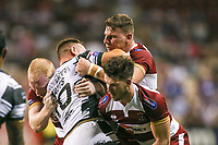 Picture by David Neilson/SWpix.com/PhotosportNZ - 10/02/2018 - Rugby League - Betfred Super League - Wigan Warriors v Hull FC  - WIN Stadium, Wollongong, Australia - Hull FC's Liam Watts is tackled by Wigan's Liam Farrell, George Williams & Oliver Gildart.