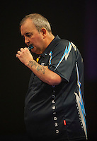 03.01.2015.  London, England.  William Hill PDC World Darts Championship.  Semi Final Round.  Phil Taylor (2) [ENG] in action during his game with Raymond van Barneveld (14) [NED]