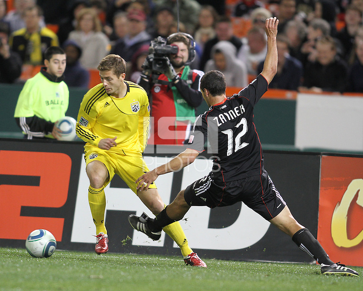 Jed Zayner#12 of D.C. United tackles  Robbie Rogers#18 of the Columbus Crew during the opening match of the 2011 season at RFK Stadium, in Washington D.C. on March 19 2011.D.C. United won 3-1.