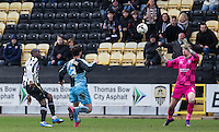 Izale McLeod of Notts County lobs Goalkeeper Ryan Allsop (Loanee from Bournemouth) of Wycombe Wanderers but cannot find the net during the Sky Bet League 2 match between Notts County and Wycombe Wanderers at Meadow Lane, Nottingham, England on 28 March 2016. Photo by Andy Rowland.