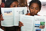 Girls study conservation booklets, Papagaran island, Komodo National Park