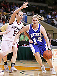 SIOUX CITY, IA - MARCH 13, 2009 --  Amber Peters #14  of Bethel College drives on Kayla Weerheim #5 of Morningside College during their game at the 2009 NAIA DII Women's Basketball National Championship at the Tyson Events Center. (Photo by Dick Carlson/Inertia)