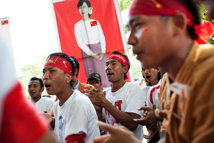 National League for Democracy (NLD) supporters participate in a rally ahead of the country's by elections, in Mingalar Taung Nyunt township, in Yangon, Myanmar, March 23, 2012. A poster of Daw Aung San Suu Kyi is held up by a protester in the background. NLD candidate Phyu Phyu Thin is running for election in the Mingalar Taung Nyunt township.