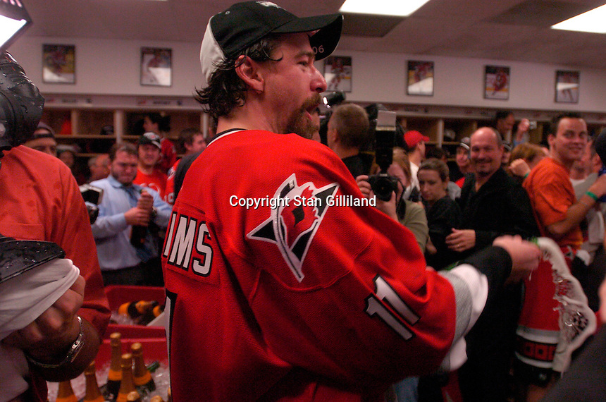 Justin Williams breaks out the champagne in the locker room. The Carolina Hurricanes beat the Edmonton Oilers 3-1 in game seven to take the Stanley Cup at the RBC Center in Raleigh, NC Monday, June 19, 2006.